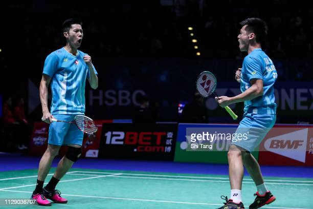 Goh V Shem and Tan Wee Kiong of Malaysia celebrate the victory after the Men's Doubles second round match against Hiroyuki Endo and Yuta Watanabe of...