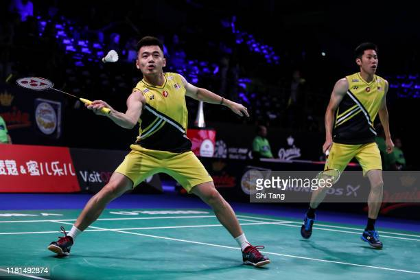 Goh V Shem and Tan Wee Kiong of Malaysia compete in the Men's Doubles first round match against Hendra Setiawan and Mohammad Ahsan of Indonesia on...