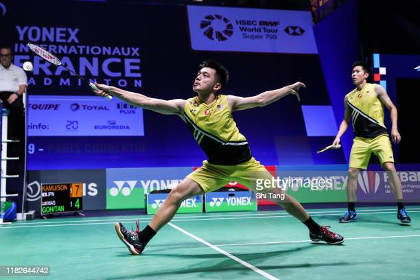 Goh V Shem and Tan Wee Kiong of Malaysia compete in the Men's Doubles first round match against Takeshi Kamura and Keigo Sonoda of Japan on day one...
