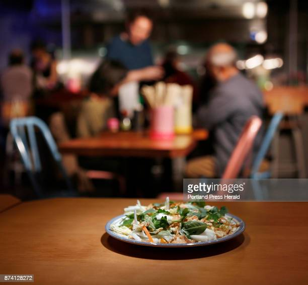 Goi Cai Bap cabbage salad with red onion peanuts fish sauce and herbs Photographed for Dine Out at Cong Tu Bot in Portland on Monday November 6 2017