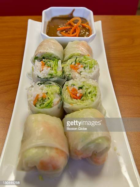 Goi Cuon made of rice paper rolled around chicken lettuce basil leaf and steamed rice vermicelli served with a side of Vietnamese peanut sauce at Pho...