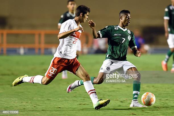 Goias' player Bruno Henrique vies for the ball with Brasilia's Bruno during their Sudamericana Cup football match at Serra Dourada Stadium in...