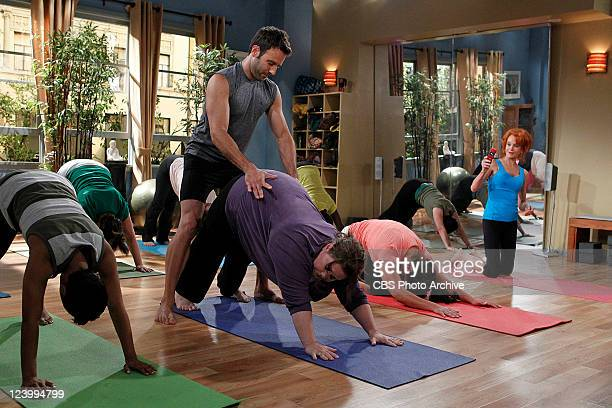 Goin' Fishin Molly gets a little help from her yoga instructor Gianni on the second season premiere of MIKE MOLLY Monday Sept 26 on the CBS...