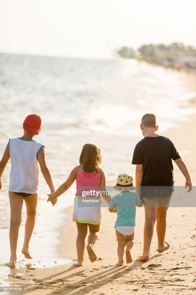 Going for a walk along the beach : Stock Photo