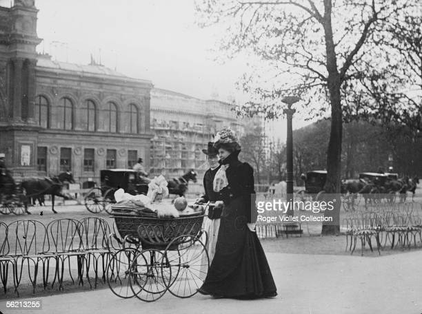 Going for a walk with baby on the ChampsElysees Paris about 1900 Musee Carnavalet