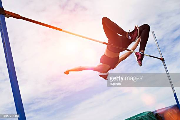 going for gold - high jump stock pictures, royalty-free photos & images