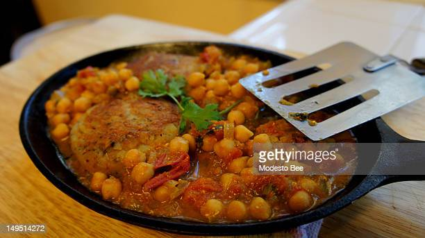 Going meatless one day a week is easy with flavorful options such as ragada which features chickpeas in a spicy tomato sauce served over a panfried...