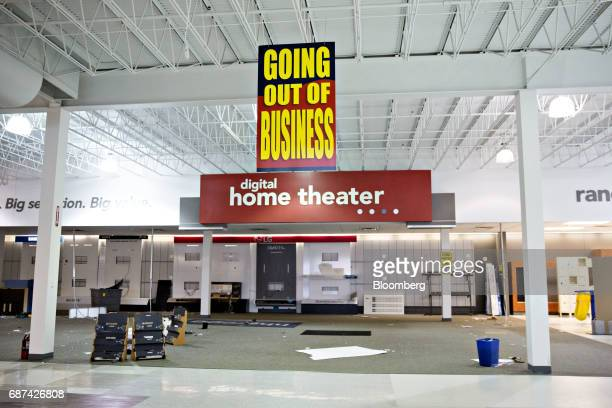 A Going Out Of Business sign hangs inside a HHGregg Inc store in Downers Grove Illinois US on Tuesday May 23 2017 The bankrupt retailer began...