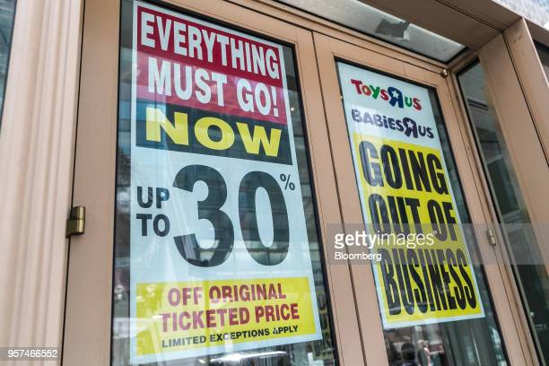 A Going Out Of Business sign hangs on display outside a Toys 'R' Us retail store at Times Square in New York US on Friday May 11 2018 As playtime...
