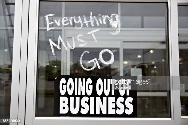 A 'Going Out Of Business' sign sits in the window of a HHGregg Inc store in Downers Grove Illinois US on Tuesday May 23 2017 The bankrupt retailer...