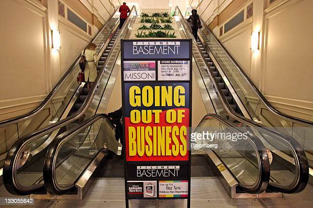 A going out of business sign stands outside of a Filene's Basement store in Chicago Illinois US on Wednesday Nov 16 2011 Bankrupt discountclothing...