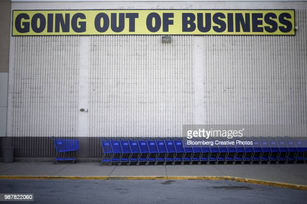 "a ""going out of business""sign is displayed outside a retail store - business closing stock photos and pictures"