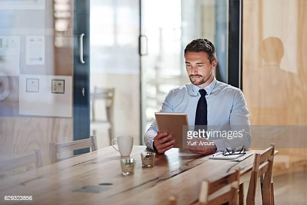 Going over his digital paperwork