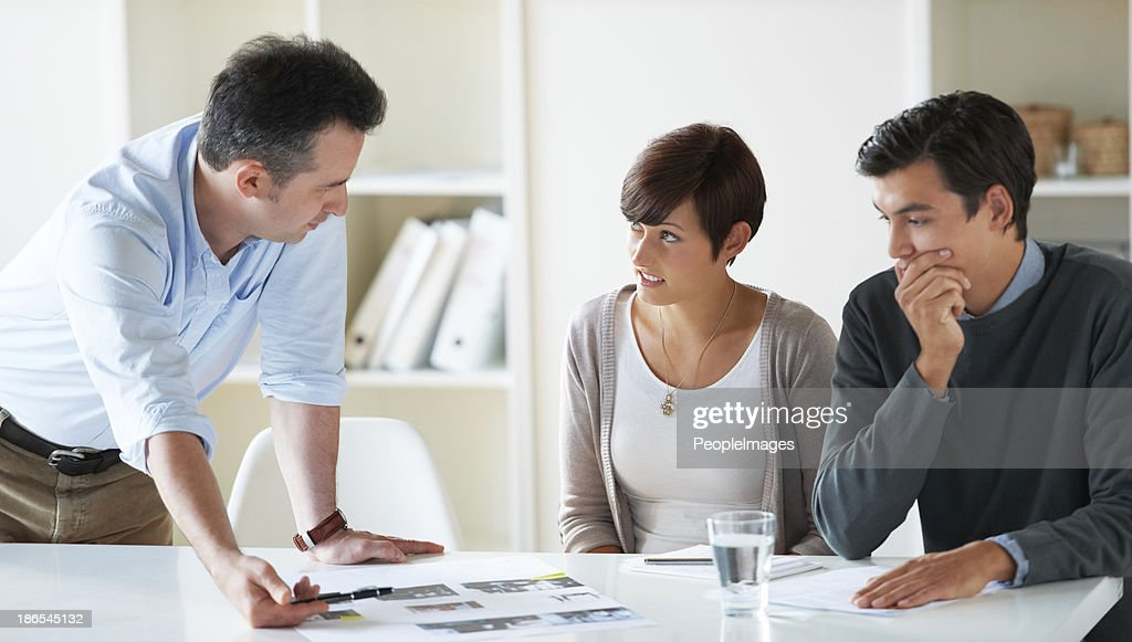 Going over stacks of paperwork : Stock Photo