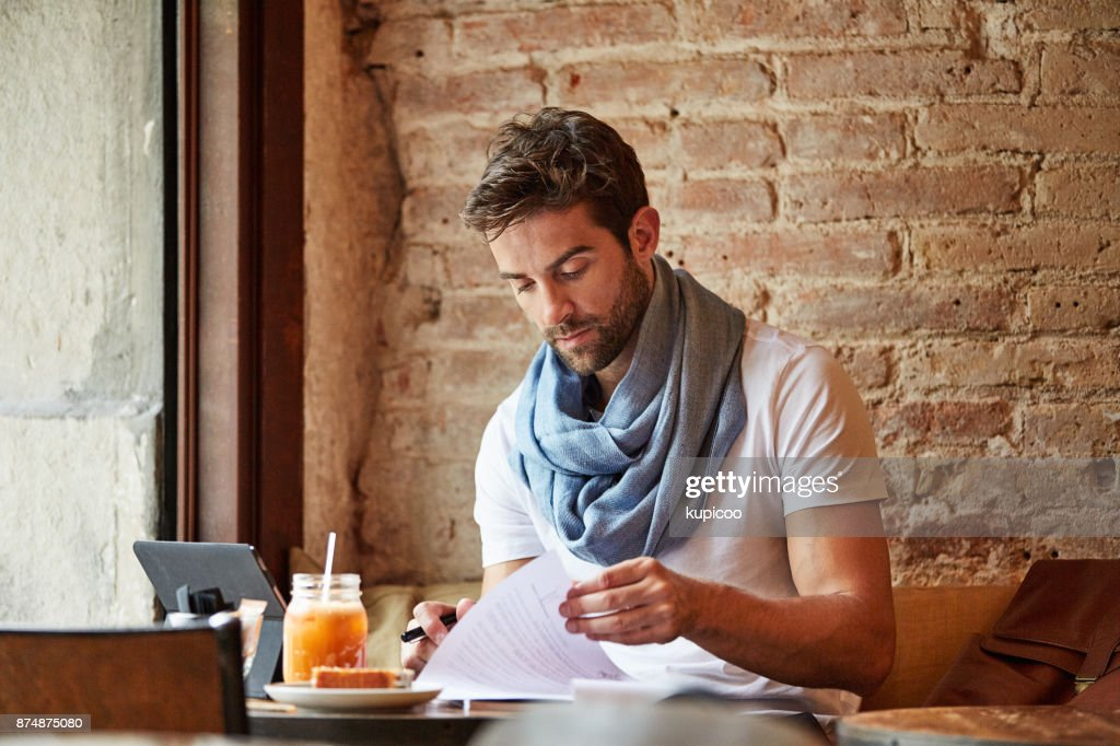Going over the paperwork : Stock Photo