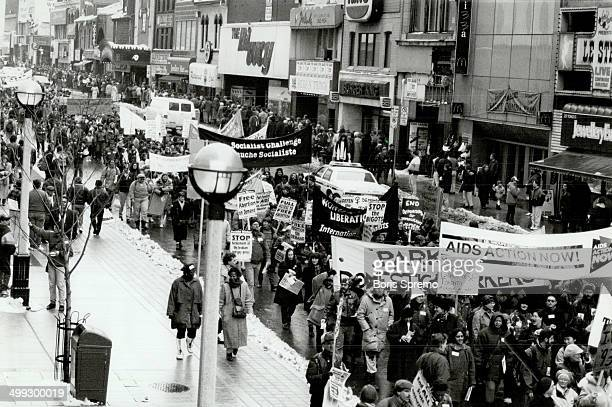 Going Strong Demonstrators raise their banners yesterday as close to 1000 join an International Women's Day march along Yonge St including a woman at...