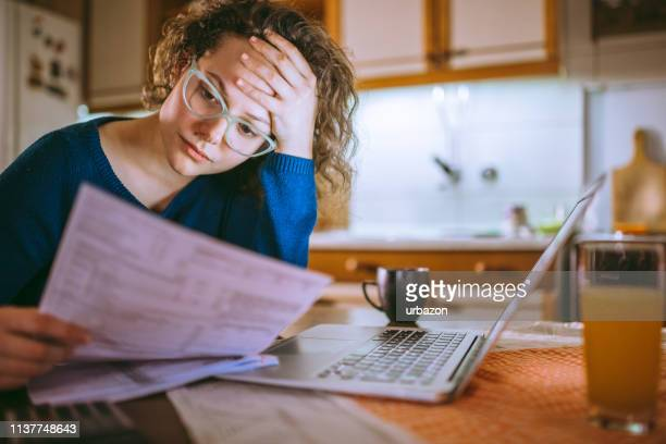 going through documents - financial bill stock pictures, royalty-free photos & images