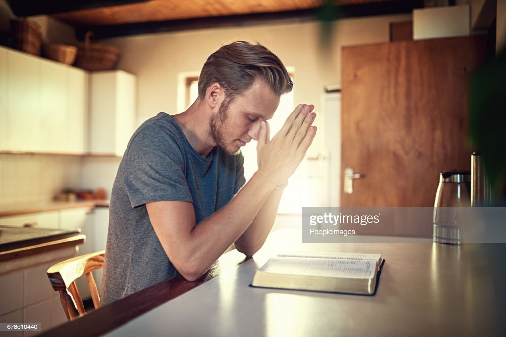 Going through his daily devotions : Stock Photo