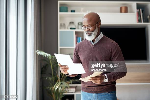 going through my statement for the month - bank statement stock pictures, royalty-free photos & images