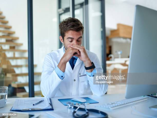 going through the stresses and strains of being a doctor - mental burnout stock pictures, royalty-free photos & images