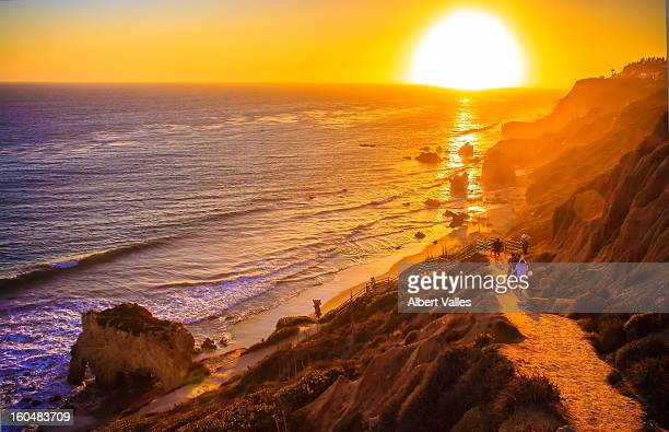 going to enjoy the autumn sunset! - malibu beach stock pictures, royalty-free photos & images