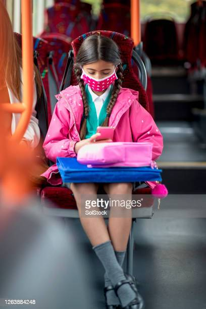 going to school during covid 19 - bus stock pictures, royalty-free photos & images