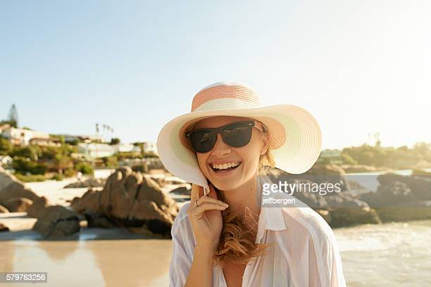 going to the beach always guarantees a good time - sun hat stock pictures, royalty-free photos & images