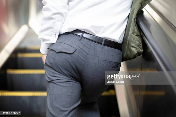 going up escalators in osaka - buttocks stock pictures, royalty-free photos & images