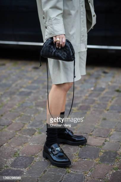 Goisa Boy seen wearing grey button shirt and shorts, Bottega bag, Prada shoes outside Baum und Pferdgarten during Copenhagen Fashion Week...
