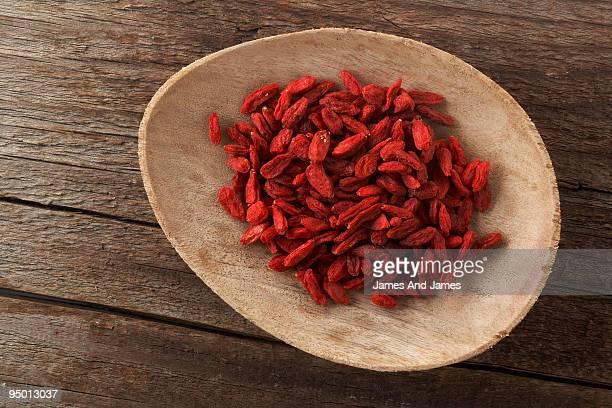 Goji Berries on wood plate