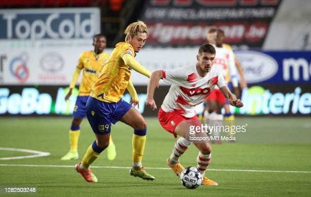 Gojko Cimirot of Standard battles for the ball with Yuma Suzuki of STVV during the Jupiler Pro League match between STVV and Standard de Liege at...