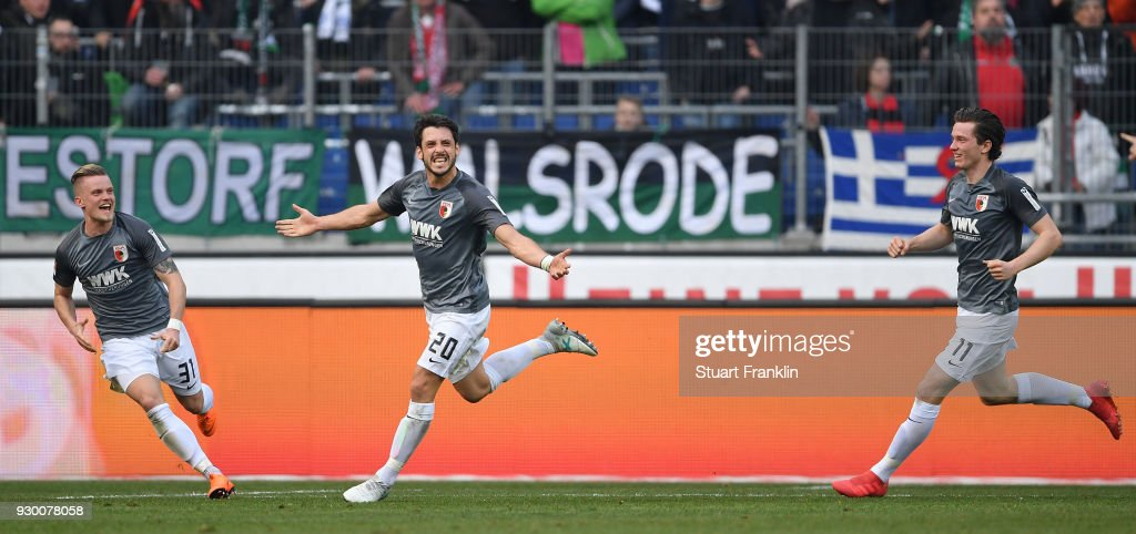 Gojko Kacar of Augsburg celebrates scoring his goal during the Bundesliga match between Hannover 96 and FC Augsburg at HDI-Arena on March 10, 2018 in Hanover, Germany.