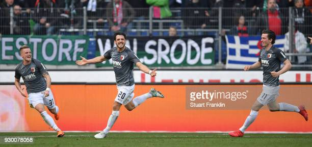 Gojko Kacar of Augsburg celebrates scoring his goal during the Bundesliga match between Hannover 96 and FC Augsburg at HDIArena on March 10 2018 in...