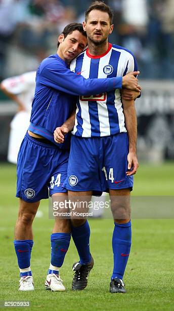 Gojko Kacar of Berlin and Josip Simunic celebrate the 10 victory after the Bundesliga match between Borussia Moenchengladbach and Hertha BSC Berlin...