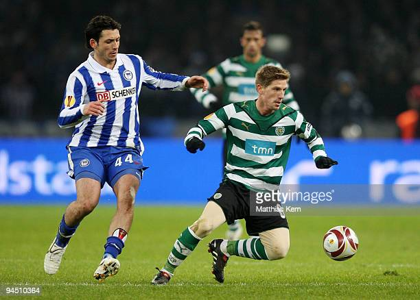 Gojko Kacar of Berlin battles for the ball with Adrien Silva of Lissabon during the UEFA Europa League match between Hertha BSC Berlin and Sporting...