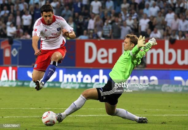 Gojko Kacar of Hamburg and Manuel Neuer of Schalke battle for the ball during the Bundesliga match between Hamburger SV and FC Schalke 04 at Imtech...