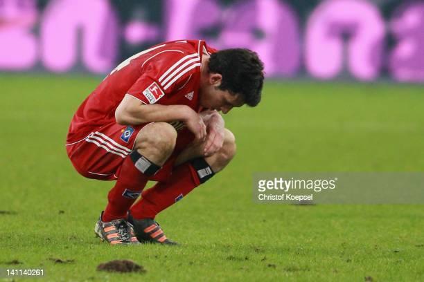 Gojko Kacar of Hamburg looks dejected after lsoiung 1-3 the Bundesliga match between FC Schalke 04 and Hamburger SV at Veltins Arena on March 11,...