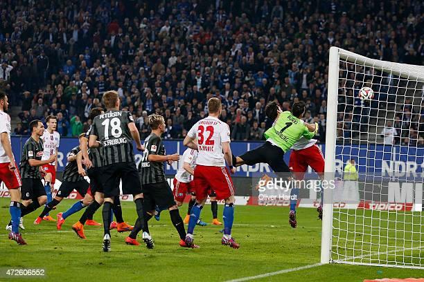 Gojko Kacar of Hamburg scores their first goal with a header during the First Bundesliga match between Hamburger SV and SC Freiburg at Imtech Arena...
