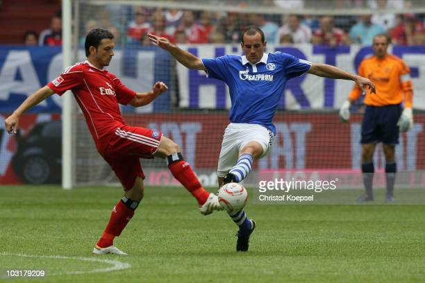Gojko Kacar of Hamburg tackles Christoph Metzelder of Schalke during the LIGA total! Cup 2010 match between FC Schalke 04 and Hamburger SV at the...
