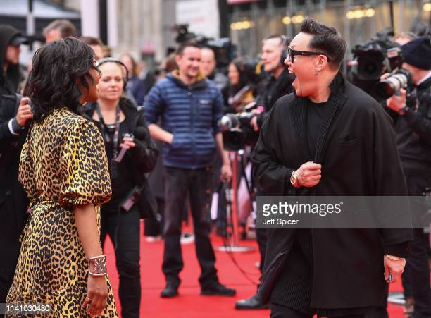 Gok Wan and Angelica Bell at The Olivier Awards with Mastercard at the Royal Albert Hall on April 07 2019 in London England