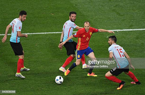 Gokhan Gonul Mehmet Topal and Oguzhan Ozyakup of Turkey surround Andres Iniesta of Spain during the UEFA EURO 2016 Group D match between Spain and...