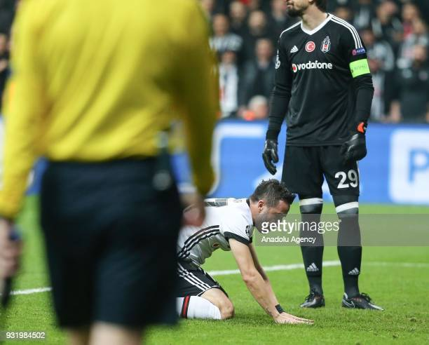 Gokhan Gonul of Besiktas gestures after scoring an own goal during the UEFA Champions League Round 16 return match between Besiktas and FC Bayern...