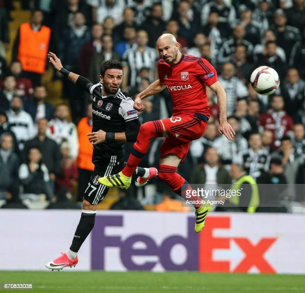 Gokhan Gonul of Besiktas in action against Chiristophe Jallet of Olympique Lyonnais during the UEFA Europa League quarter final second match between...