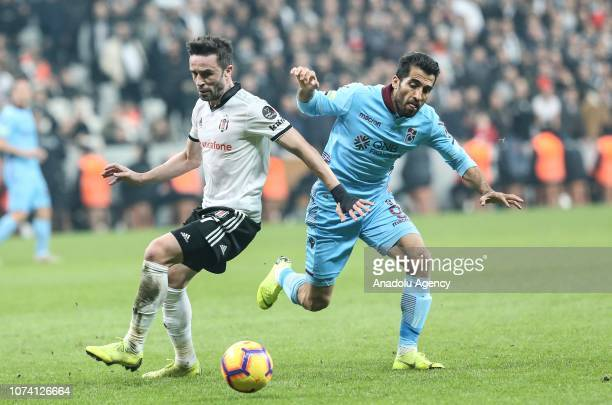 Gokhan Gonul of Besiktas in action against Vahid Amiri of Trabzonspor during Turkish Super Lig soccer match between Besiktas and Trabzonspor at the...
