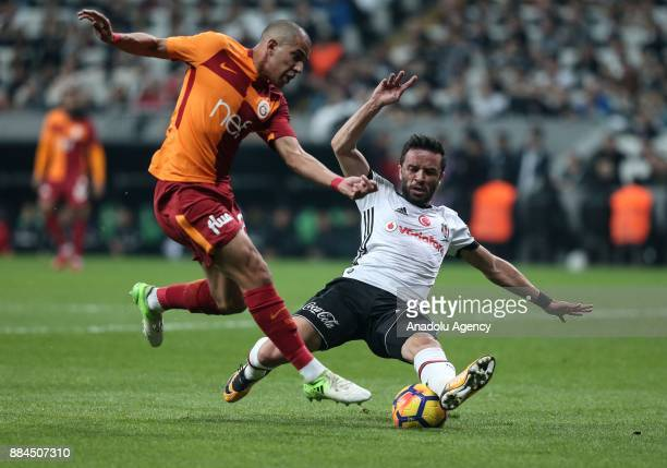 Gokhan Gonul of Besiktas vies with Feghouli during the Turkish Super Lig match between Besiktas and Galatasaray at Vodafone Park in Istanbul Turkey...
