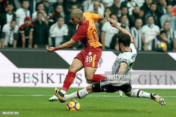 Gokhan Gonul of Besiktas vies with Feghouli of Galatasaray during the Turkish Super Lig match between Besiktas and Galatasaray at Vodafone Park in...