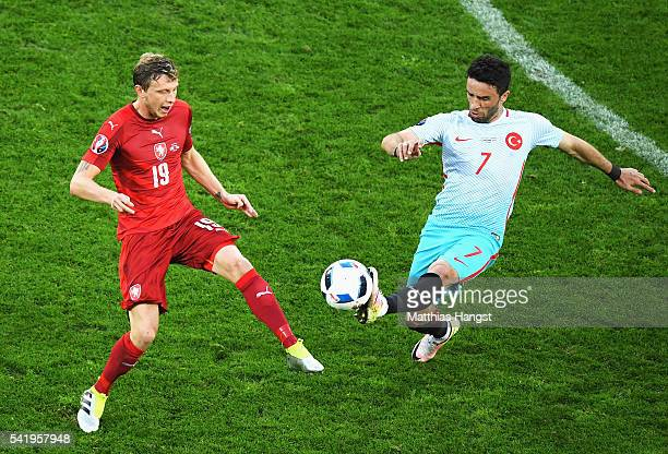 Gokhan Gonul of Turkey gets to the ball ahead of Ladislav Krejci of Czech Republic during the UEFA EURO 2016 Group D match between Czech Republic and...