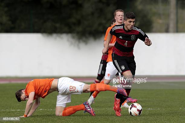 Gokhan Gul of Germany challenges Teun Koopmeiners of Netherlands during the U17 Algarve Cup match between Netherlands and Germany at Municipal...