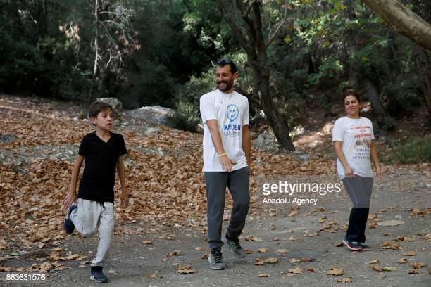 Gokhan Guneri and his wife Zeliha Guneri jog with their child Fatih Guneri who was diagnosed with the cystic fibrosis disease due to Fatih's...