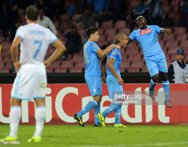 Gokhan Inler of Napoli celebrates after scoring their first goal during the UEFA Champions League Group F match between SSC Napoli and Olympique de...